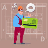 Casa Real Estate de la venta de Hold Credit Card del constructor de la historieta sobre trabajador abstracto del varón del fondo  Foto de archivo