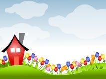 Casa roja y fila de tulipanes en resorte