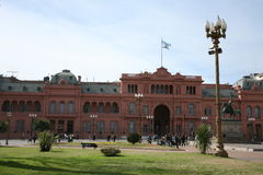 Casa Rosada Government House. Government House in Buenos Aires Argentina called: Casa Rosada.  Colonial looking with flagpole with park in foreground Royalty Free Stock Photography