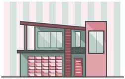 Casa rosada y verde Imagen de archivo