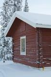 Casa rossa in neve Immagine Stock