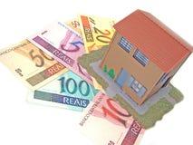 Casa sobre el dinero Imagenes de archivo