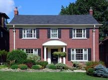 Casa suburbana con gli otturatori Immagine Stock Libera da Diritti