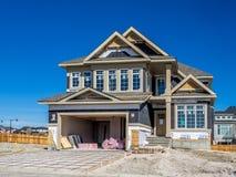 Casa suburbana della proprietà in costruzione Fotografia Stock