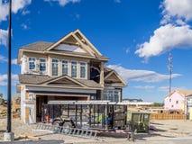 Casa suburbana della proprietà in costruzione Fotografie Stock Libere da Diritti