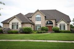 Casa suburbana do tijolo Fotos de Stock