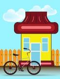 Casa suburbana Front View Building y bicicleta con la cerca de madera Imagenes de archivo