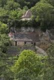 Casa tallada en acantilados Imagen de archivo libre de regalías