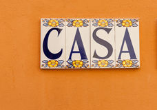 CASA tiled on wall. Word CASA tiled on orange wall Royalty Free Stock Images