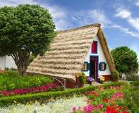 Casa tipica del negozio di fiore del souvernir, Madera Immagine Stock