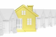 Casa unica dorata che sta fuori dalla fila di case Immagine Stock