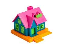Casa variopinta del giocattolo su una priorità bassa bianca Fotografia Stock