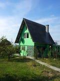 Casa verde del campo Foto de archivo libre de regalías