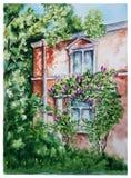 Casa vieja con Bush de la lila en St Petersburg Fotografía de archivo