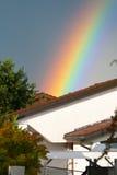 Casa y arco iris Imagenes de archivo