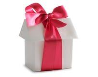 Casa y cinta roja Imagen de archivo libre de regalías