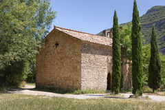 Casa y ciprés tres imagenes de archivo