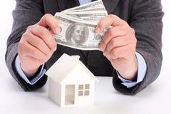 Casa y dinero imágenes de archivo libres de regalías