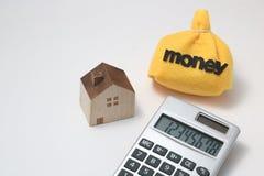 Casa y dinero Imagen de archivo libre de regalías