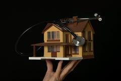 Casa y estetoscopio Fotografía de archivo
