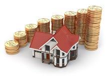 Casa y gráfico de monedas. Aumento de las propiedades inmobiliarias. Fotos de archivo libres de regalías