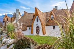 Casa y jardín de la arcilla de la mazorca Imagen de archivo