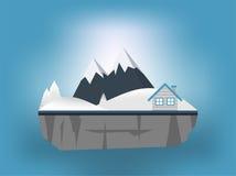 Casa y montaña en invierno Imagenes de archivo