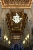 Symmetrical interior in the Mosque of Hassan II. In casablanca morocco, famous mosque landmark, luxurious and shining, golden decoration background stock photography