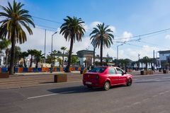 Casablanca, Morocco - 11 January 2018 : Red Taxi passing near Palace of Justice Stock Photo