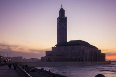 View of Hassan II mosque from the walk alley at the Sunset Royalty Free Stock Photos