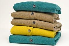 Casacos de lã antiquados da V-garganta Imagens de Stock