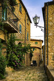 Casale Marittimo old stone village in Maremma. Picturesque flowery street and traditional houses. Tuscany, Italy. royalty free stock image