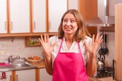 Casalinga infelice in cucina Immagine Stock Libera da Diritti