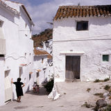 CASARES, SPAIN. Street in Casares with people Stock Images