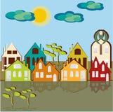 Casas, cielo y nubes Foto de archivo
