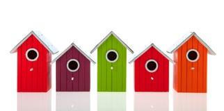 Casas coloridas do pássaro fotos de stock royalty free