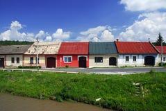 Casas coloridas em uma fileira Fotos de Stock Royalty Free