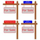 Casas com sinais Fotografia de Stock Royalty Free