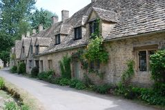Casas da fileira de Arlington, Bibury, Inglaterra, Reino Unido imagem de stock