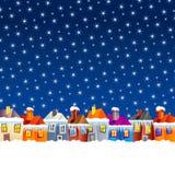 Casas da vila dos desenhos animados no inverno Foto de Stock Royalty Free