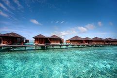 Casas de campo da água no recurso maldivo Fotos de Stock Royalty Free