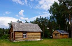 Casas de campo de madera Imagenes de archivo