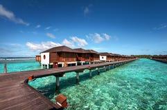 Casas de campo luxuosas da água do recurso maldivo Imagem de Stock Royalty Free