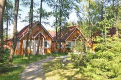 Casas de campo nas madeiras Imagem de Stock Royalty Free