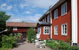 Casas de campo vermelhas pitorescas Foto de Stock