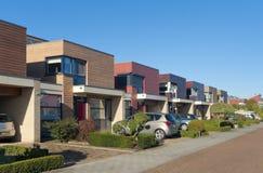Casas de cidade modernas imagem de stock