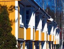 Casas de ciudad amarillas suecas Imágenes de archivo libres de regalías