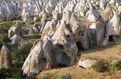 Casas de la cueva de Cappadocian Imagenes de archivo