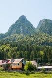 Casas de las montañas Imagenes de archivo