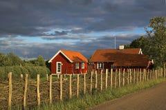 Casas de madeira vermelhas Imagens de Stock